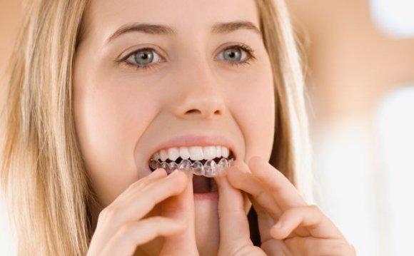 A young woman doing tooth